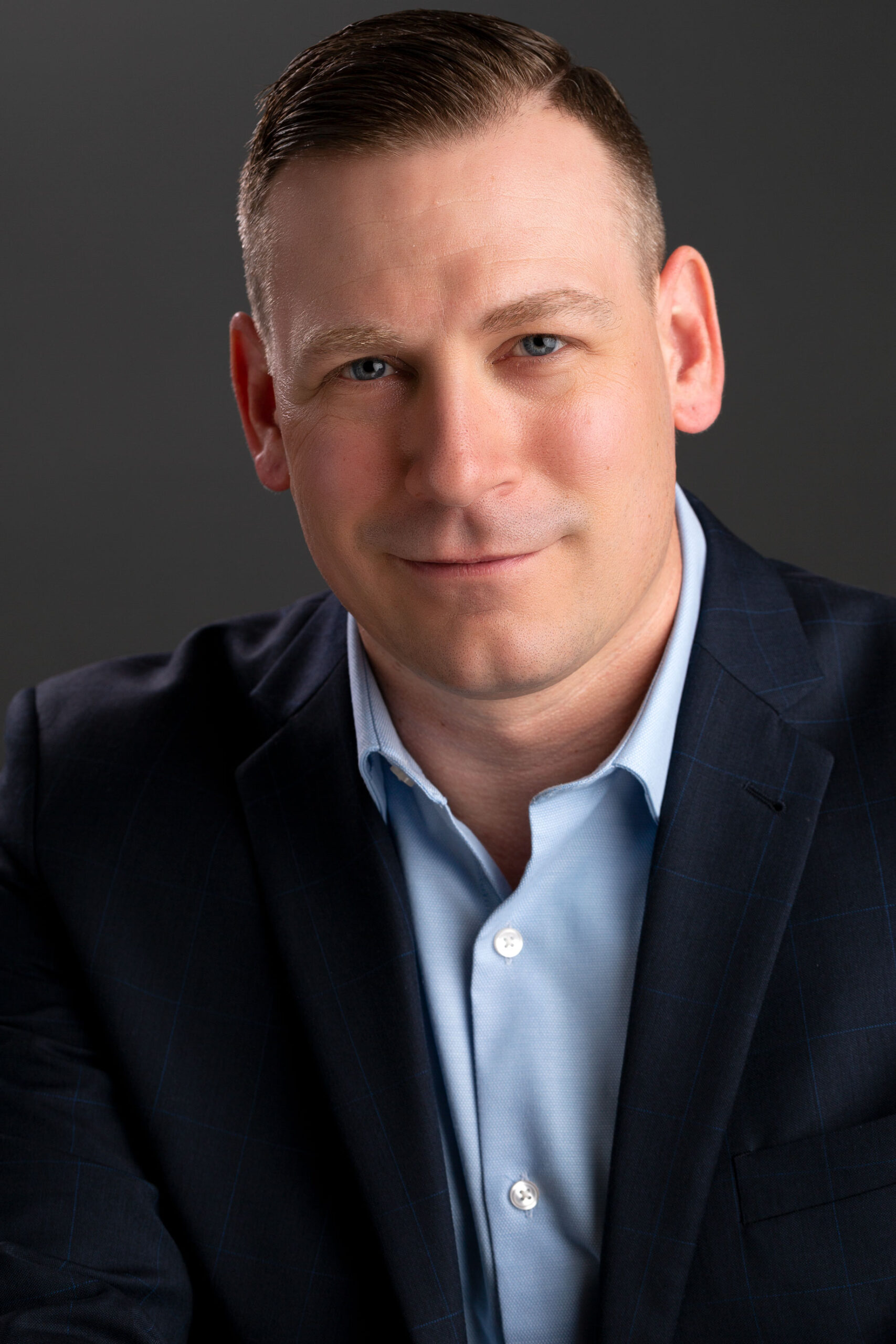 Headshot of a man in casual business attire