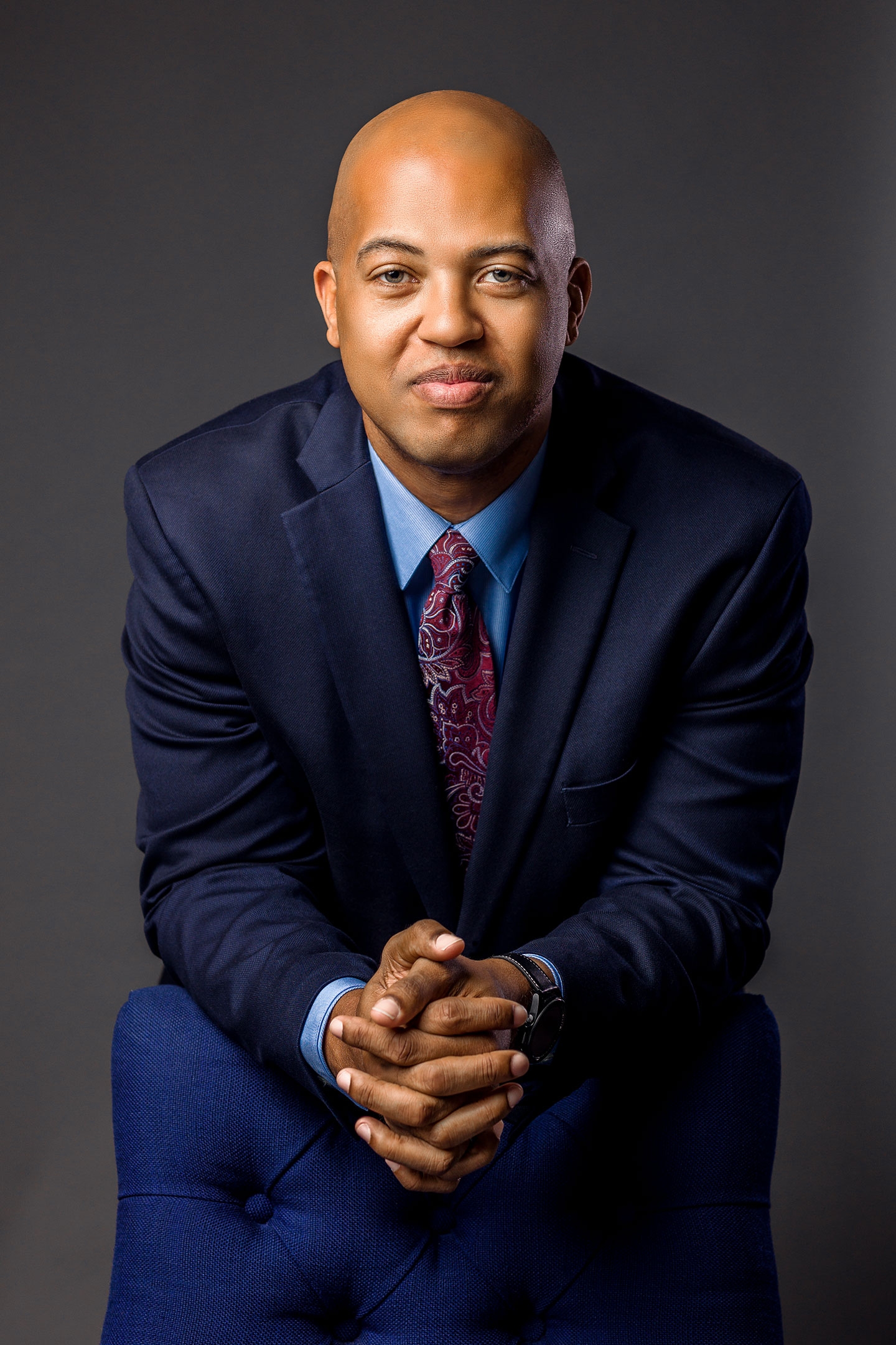 Business Headshot of an African American man in a blue suit